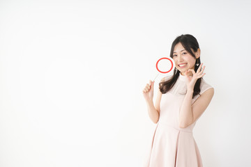 Young woman showing the circle sign