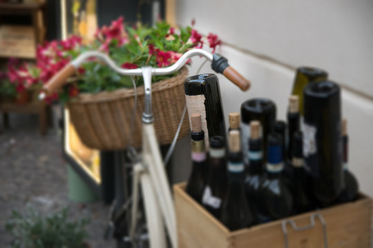 Decorative Bicycle with flowers and wine bottles