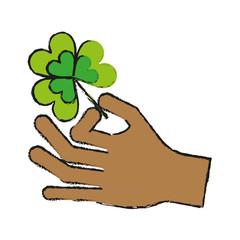 hand holding shamrock or clover leaf saint patricks day related