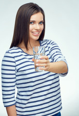 Smiling girl with dental braces shows water glass.