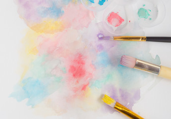 Brush painted pastel pink, yellow, green, purple, blue water colour bakground