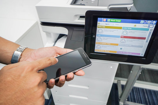 close up businessman print the documents by application in smartphone