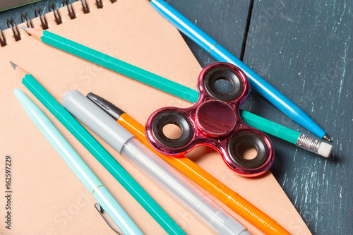 spinner notebook and pencil on the table stock photo and royalty