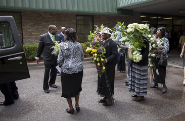 Flowers for Walter Scott are transported to a waiting limousine outside the W.O.R.D. Ministry Christian Center in Summerville