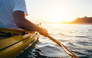 Close up of man holding kayak paddle
