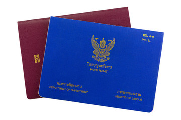 Blue Thai Work Permit book on electronic passport isolated on white background.