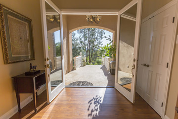 Doors to the house and a view of both inside and outside