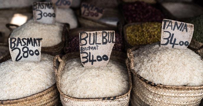 different rice kinds sale in full sacks at Zanzibar market street, Africa