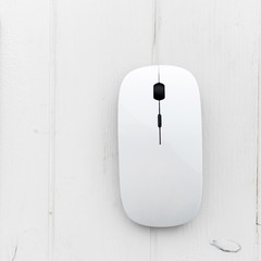 White mouse on a white table, top view