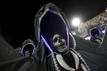 Revellers of the Estacio de Sa samba school perform during the carnival parade at the Sambadrome in Rio de Janeiro