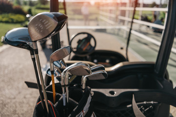 Close-up view of golf club heads in bag on the golf cart