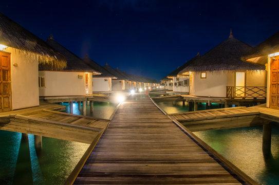 A night scene of sea bungalows at Maldives