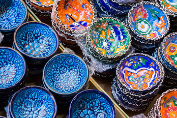 Traditional Cretan painted ceramic dishes for sale at a city centre shop Crete, Greece, Europe.