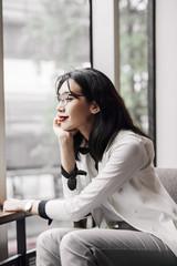 Portrait of beautiful elegant smart Asian businesswoman looking happy.