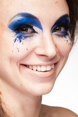 Woman with blue creative make up in studio photo