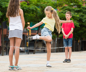 Acrylic Prints Dance School Happy kids playing with chinese jumping rope