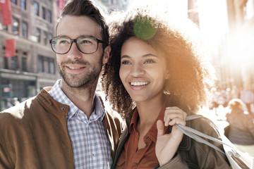 Cheerful couple doing shopping in Manhattan, New York city