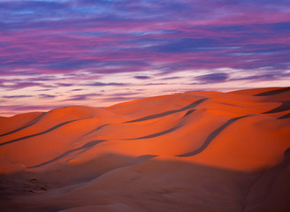 Sand dunes at sunset in Sahara desert in Morocco, North Africa