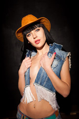 sexy girl in cowboy hat and jeans