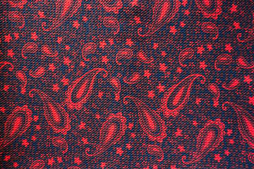 Fabric with Paisley pattern in red and black
