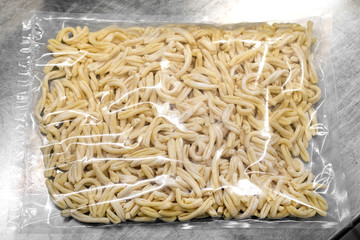 Vacuum-packed fresh Italian pasta in plastic