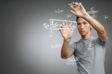 Man scientist or student working with various high school maths and science formulas.