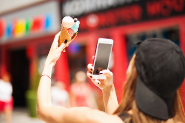 Summer girl taking picture of ice cream