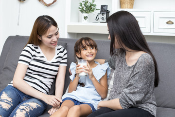 Kid show for drinking milk with woman at home, happy family concept, 3 person