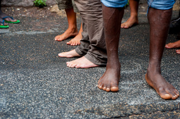 african immigrants bare feet at march asking for hospitality for refugees in Rome