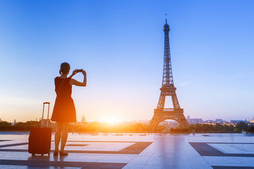 Woman traveler taking photo of Eiffel Tower from Trocadero