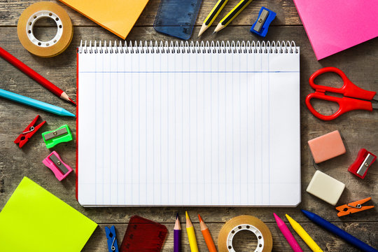 School supplies on wooden background. Back to school concept. Copyspace.
