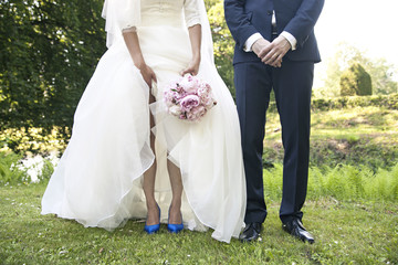Legs of a wedding couple