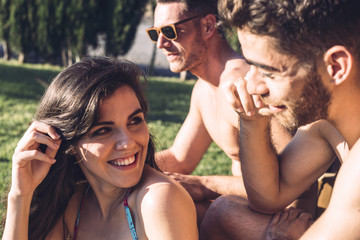 Pretty girl smiling while talking to guy
