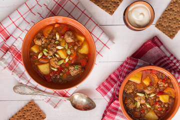 Lentil soup with meatballs and cream sauce