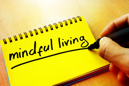 Mindful living written in a note.