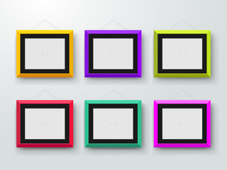 Empty colored photo frames on the wall. Design for a modern interior. Horizontal A-4. Vector illustration. Isolated on gray background
