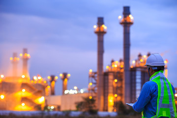 oil refinery plant at sunrise with sky background,blur,bokeh