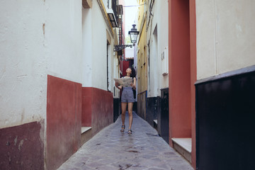 Lost woman exploring surroundings of street
