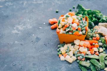 Frozen vegetables. Frozen vegetable mixture of carrots, corn and peas.