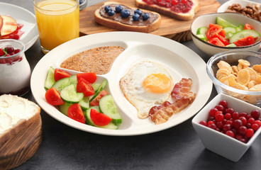 Delicious served breakfast on table