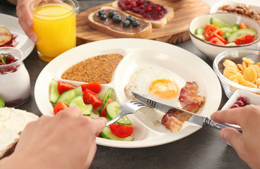 Family having tasty breakfast at table