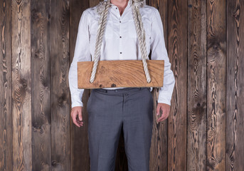 Businessman with a wooden frame