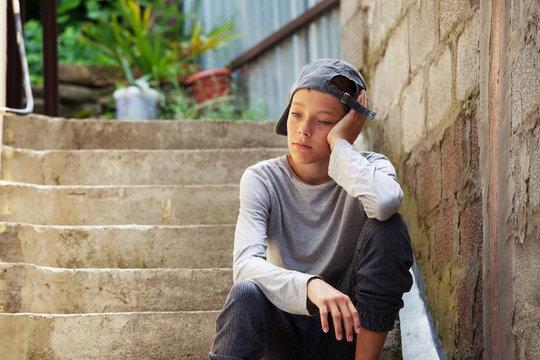 Sad teen outdoors