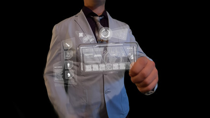 Man with a futuristic screen.  The concept of the future interface on a transparent display
