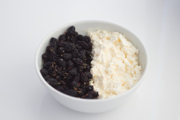 Morus nigra called Mulberry with black color and cottage cheese . In white plate. Background.