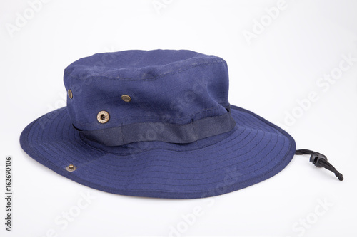 d87ffb7b7 Blue adventure hat on a white surface. Safari at isolated on white ...