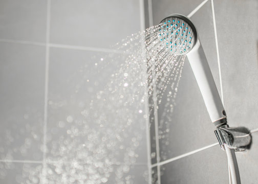 Droplets flowing from shower