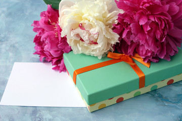 peonies flowers with gift box