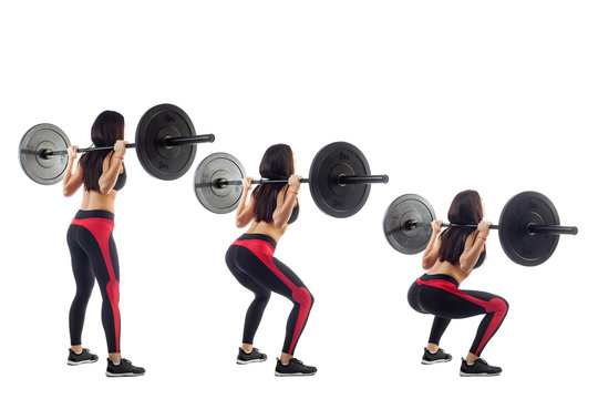 Woman doing squat  with a barbell