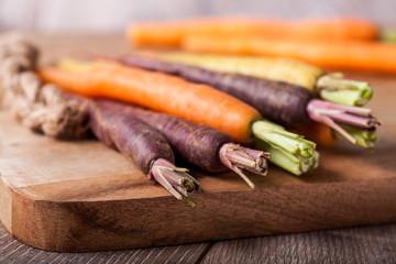Rainbow Carrots on a Chopping Board